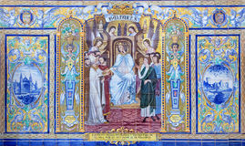 塞维利亚-作为其中一间的巴利阿铺磁砖的'省凹室'沿广场de西班牙的墙壁 免版税图库摄影