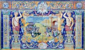塞维利亚-作为其中一间的巴达霍斯铺磁砖的'省凹室'沿广场de西班牙的墙壁 库存照片