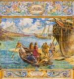 塞维利亚-作为其中一间的Canarias铺磁砖的'省凹室'沿广场de西班牙的墙壁 免版税库存图片