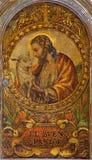 塞维利亚-作为好牧羊人的耶稣基督 在临时房屋的油漆在教会Iglesia de圣罗克里 库存图片
