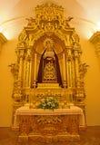 塞维利亚-圣母玛丽亚巴洛克式的旁边法坛在卡皮亚de la Universidad (大学教堂) 免版税库存照片