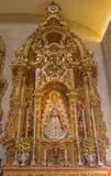 塞维利亚-旁边法坛从年1718 - 1731何塞梅斯特里在萨尔瓦多(Iglesia del萨尔瓦多)的巴洛克式的教会里 库存照片