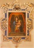 塞维利亚-玛丹娜油漆在教会Iglesia de由未知的画家的圣玛丽亚马格达莱纳里 库存照片