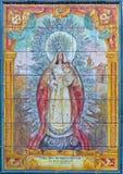 塞维利亚-从20的陶瓷铺磁砖的玛丹娜 分 在教会Iglesia圣胡安de la帕尔马门面  免版税库存照片