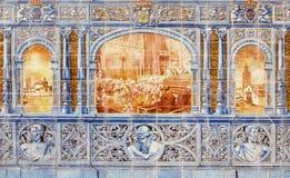 塞维利亚-跳舞的Los占领图象作为铺磁砖的'省凹室的'一部分沿广场de西班牙的墙壁 库存照片