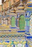 塞维利亚-铺磁砖的'省凹室'沿广场de西班牙(20世纪20年代)的墙壁多明戈Prida 免版税库存照片