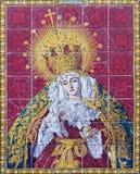 塞维利亚-陶瓷铺磁砖的哭泣的玛丹娜(哀痛的夫人)教会Iglesia los Terceros门面的  库存图片