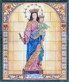 塞维利亚-陶瓷铺磁砖的玛丹娜在教会Basilica del由艺术家M的玛丽亚Auxiliadora里 从20的罗梅罗 分 免版税库存照片