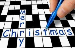填装在纵横填字谜-圣诞快乐的手 免版税库存照片