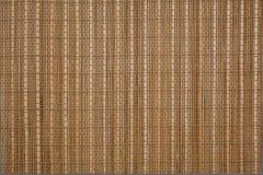 填装整个框架的轻的树荫竹席子的纹理 免版税图库摄影