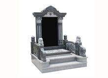 墓碑整理了与在白色背景的石狮子 免版税库存照片