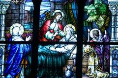 墙壁上宗教的彩色玻璃 免版税库存照片