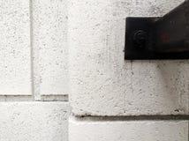 墙壁和钢坚果 库存图片