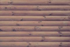 墙壁完成与现代自然圆的棕色木材作为背景 库存图片
