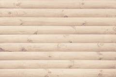 墙壁完成与现代自然圆的没有漆的木材作为背景 免版税图库摄影
