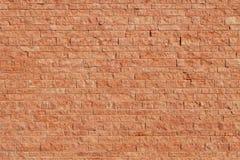 墙壁由红砖色的石头块做成 库存图片