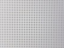 墙壁白色背景有孔的 设计,概念 库存照片