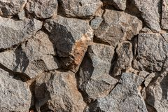 墙壁的片段从一块切削的石头的 免版税图库摄影