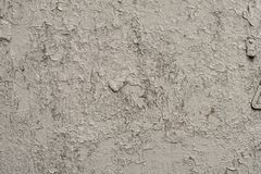 墙壁的白灰色表面有破裂的油漆的,膏药,特写镜头 免版税库存照片