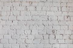 墙壁的纹理从一块白色砖的有规则放置的背景 免版税库存照片