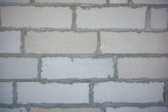 墙壁背景有砖的 从气体块的墙壁 酿造 免版税库存图片
