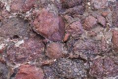 墙壁自然特写镜头红色花岗岩石头的片段 免版税库存图片