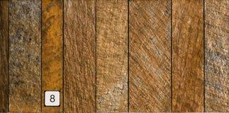 墙壁金属细节在红色铁花岗岩垂直平板的 图库摄影
