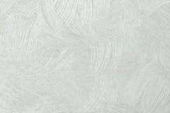 贴墙纸在轻的乌贼属被定调子的,灰色和丝毫的纹理背景 库存照片