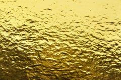 墙纸装饰元素的金箔叶子发光的包装纸纹理背景 免版税库存照片