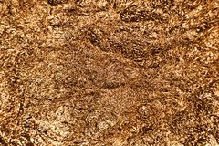 墙纸装饰元素的金箔叶子金属包装纸发光的纹理背景 免版税图库摄影