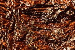 墙纸装饰元素的金箔叶子金属包装纸发光的纹理背景 免版税库存图片