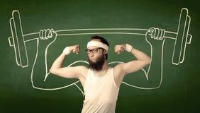 增强的人重量年轻人 免版税图库摄影
