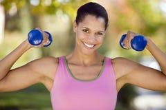 增强的重量妇女 免版税库存照片