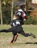 增进橄榄球比赛青年时期 免版税库存图片