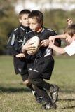 增进橄榄球比赛青年时期 库存照片