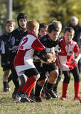 增进橄榄球比赛青年时期 图库摄影