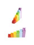 增长的堆被隔绝的玩具砖 免版税库存照片