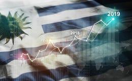 增长的统计财政2019年反对乌拉圭旗子 免版税库存照片