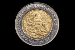 墨西哥人一比索硬币关闭在黑色 免版税图库摄影