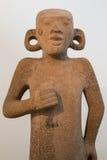 从墨西哥的玛雅人石雕象有在耳朵的孔的 免版税库存照片