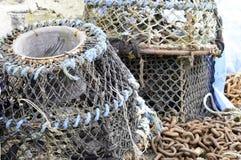 墨水池龙虾和捕蟹篓 免版税库存照片