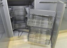 壁角碗柜在有架子的一个厨房里 免版税库存图片