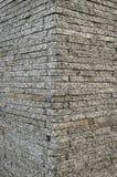 壁角花岗岩石头砖墙的背景纹理 免版税库存照片