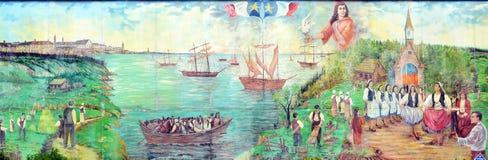 壁画讲acadians人故事  免版税库存照片