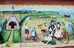 壁画讲acadians人故事  库存图片