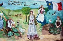 壁画讲acadians人故事  免版税图库摄影