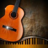 声学吉他和钢琴难看的东西背景 库存图片