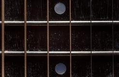声学吉他脖子细节 免版税库存图片