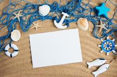壳、seastars和一张空白的明信片 库存照片