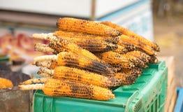 处理甜点的暴力行为的玉米行业 图库摄影